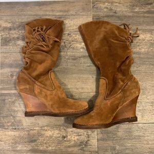 Women's Arnold Churgin suede fringe wedge boots